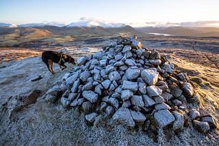 Kiri examines the cairn