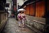 Two girls wearing kimono passing alleyway (snowpine) Tags: street streetphotography streetportrait candid people japan kyoto kimono traditionalcloth traditional alley oldbuilding rain walking nikon nikond850 lifestyle