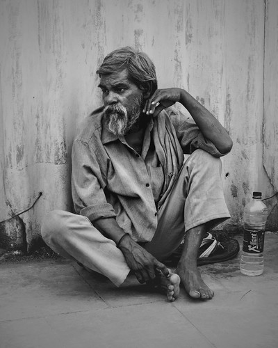 Portrait of an Indian man waiting for his train.