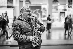 20171229_F0001: Street saxophone player (wfxue) Tags: musician saxophone windinstrument brassinstrument instrument glasses portrait people candid street blackandwhite bw bnw monochrome
