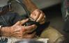DSC_3502 (foxunknow) Tags: hands oldman grandpa granfather abuelo anciano manos hombre persona gente chile santiago nikon 50mm d7100 trabajo work working zapato shoes zapatero