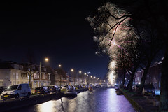 Oud & Nieuw (zsnajorrah) Tags: urban fireworks explosion water canal reflection cars transportation streetlights trees silhouette shadow night longexposure 7dmarkii ef2470mmf4l netherlands haarlem langeherensingel langeherenvest oudennieuw street houses bridge boat feast captureonepro c1p