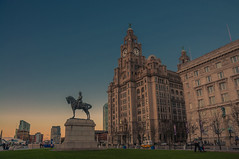 Liverbirds at the end of the day (Tony Shertila) Tags: europe britain england merseyside liverpool waterfront sunset evening outdoor liverbuilding statue threegraces liverbird architecture unitedkingdom