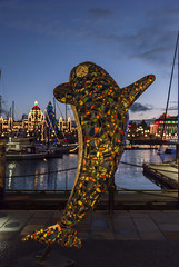 2017-12-15_18-03-07 Colorful Orca (canavart) Tags: victoria bc canada britishcolumbia vancouverisland evening christmas harbor harbour provinciallegislature bclegislature building sailboats dusk lights francismawsonrattenbury francisrattenbury rattenbury orca statue mosaic