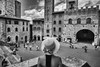 san gimignano (Roberto.Trombetta) Tags: italy italia road piazza toscana bianco nero black white bw bn tuscany path siena val dorcia orcia san gimignano landscape paesaggio panorama long hair hat cappello tourist turista sony 7rii zeiss carlzeiss sony7rii batis 25 woman girl amazing view beautiful wonderful stunning fineart fine art summer estate batis225 model fashion people 7rm2 allaperto clouds campo monochrome blackandwhite