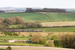 Great Western Railway train in Dorset landscape (Joe Dunckley) Tags: britain british class150 dorchester dorset dorsetdowns embankment england english firstgreatwestern gwr greatbritain greatwesternrailway heartofwessexline sprinter uk unitedkingdom westdorset aerialview agriculture arable birdseyeview countryside crop dieselmultipleunit dmu farm farming farmland field fields fromabove hill landscape nature outdoors passengertrain railway road rollinghills rollinglandscape street train transport transportation