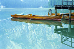 Lago di Braies, Italy: Two Boats Reflect (rocinante11) Tags: italy italia braies lagodibraies lake blue reflection dolomites dolomiti mountains boathouse pragserwildsee film