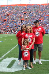 2016_T4T_University of Florida 51 (TAPSOrg) Tags: taps tragedyassistanceprogramsforsurvivors teams4taps gainesville florida universityofflorida football collegefootball salutingthosewhoserve survivors 2016 military outdoor vertical redshirt footballfield family group candid women girl kid child male