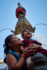 Nepali woman and baby in front of a stupa, Kathmandu, Nepal (Alex_Saurel) Tags: statue portrait sandales sourire portraiture smile posing portray sandals halfbody asie culture 35mmprint scans pose asian pattern motif stupa dents group people cheveuxnoirs asia streetscene architecture travel hands lifescene imagetype baby teeth photoreport photospecs photoreportage reportage laughting mainsjointes arms goldenstupa stupatower rires photojournalism joinedhands stockcategories doigtscroisés smilling day crossedfingers plantaille traditional blackhairs time shorten tradition nepal scènedevie lifestyles sony50mmf14sal50f14