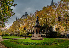 Whitehall Gardens in the rain (Explored) (Geoff Eccles) Tags: grass autumn thames england historic jkingdom whitehall buildings fall light unitedkingdom vistoria raining horseguards uk river trees outram embankment park gardnes rain london britain
