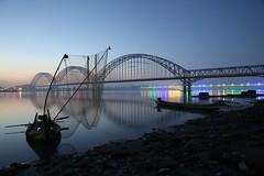 calm (PawL23) Tags: sagaing myanmar burma fishingboats dawn bluehour newavabridge reflection bridge silhouette oldavabridge