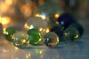 marbles lit by candlelight (photos4dreams) Tags: spiele spiel spielzeug murmeln marbles glass glas blue blau glasmurmelsammler murmel marble klicker photos4dreams photos4dreamz p4d glasmurmel hmm macromondays candle candllight litbycandlelight