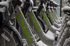 Hubway Bikes (brucetopher) Tags: bike rideshare green hubway rent rental share transportation travel winter snow city pattern perspective h ride bicycle angle linear