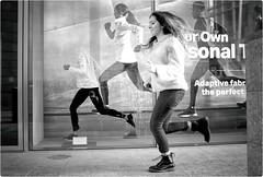 Born to Run (Steve Lundqvist) Tags: fujifilm x100s x100 run running ad advertising nike girl milan italy streetphotography street juxta juxtaposition bw monochrome people sport sporty shop window athletic athlete action shot boot