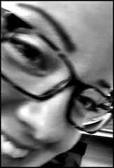 Melissa (Bob R.L. Evans) Tags: glasses youngwoman face smile smilingwoman blackandwhite graytones ipadphotgraphy eyes eyebrow teeth nose lowkey