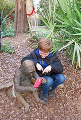 Its all fun and Games until Ceasar figures it all out (babyfella2007) Tags: bronze art statue ape gorilla grant child cell phone posed riverbanks zoo columbia sc south carolina jason taylor boy young winnsboro fun christmas 2017 exploring memaw grandmother keith carson stature elephant grocery store kroger blythwood tree lights balls face expression family old goat tongue jeremy kimberly michelle mary lou hall cold winter coca cola soft drink soda isle cereal food
