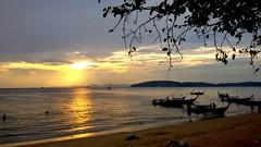 Sunset @ Aonang Beach (stardex) Tags: aonangbeach aonang beach seaside sea sunset dusk tree sky cloud sun silhouette boat thailand krabi