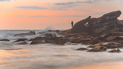 Dawn Seascape and Fisherman (Merrillie) Tags: daybreak shoreline sand landscape nature australia surf outdoors rocks killcarebeach newsouthwales waves centralcoast nsw clouds beach ocean water coastal dawn photography sea sky seascape waterscape coast killcare fisherman