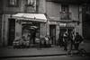 Downtown.... (Dafydd Penguin) Tags: street candid shot photo urban people bike road shop blackandwhite blackwhite black white bw mono monochrome noir nikon df nikkor 20mm af f28d barcelona spain catalunya catalonia europe raw