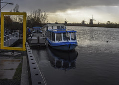 Kinderdijk Windmills (trainmann1) Tags: nkon d7200 nikkor 18200mm amateur handheld november 2017 fall europe vikingrivercruise honeymoon vacation kinderdijk kinderdijkwindmills windmills monuments unesco unescoworldheritagesite dutch manmade boat canal waterway blue yellow green orange