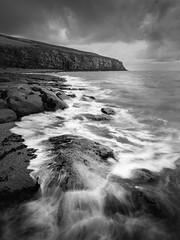 Fleswick bay (Ade G) Tags: bw landscape rocks seascape weather cliffs clouds coast longexposure