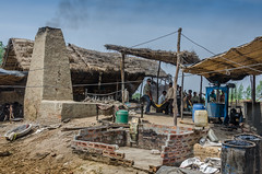 The family factory (Pejasar) Tags: family business sugarcane processing near delhi india home work carry load factory processingplant labor men sky smoke heat