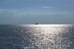 _LCT8687_resized (lctphoto) Tags: boat sea sunset glittering calm water bluesky