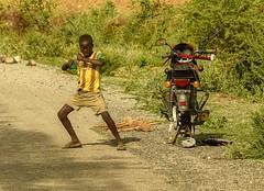 Konso Boy (Rod Waddington) Tags: africa african afrique afrika äthiopien ethiopia ethiopian ethnic etiopia ethnicity ethiopie etiopian omo omovalley outdoor omoriver motorbike boy konso tribe traditional tribal crafts road roadside