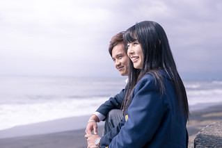 High school student couple looking at coastline