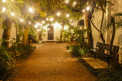 Courtyard Magic Draws Me In (rocinante11) Tags: light ambientlight night path bricks brick bench orlando florida
