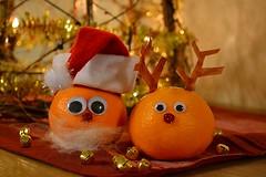 Delicious decoration... or... funny food!? ;-) (Maria Godfrida) Tags: christmas xmas decoration food funny tangerine mandarin santahat orange glittering cute bokeh closeup santa reindeer two pair couple 7dwf challengeonflickr
