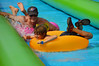 With dad right behind ready with a push (radargeek) Tags: slidethecity 2016 summer july waterslide splash kids children child dad father son sunglasses oklahomacity okc oklahoma downtown
