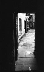 Bashful Alley Lancaster UK (Man with Red Eyes) Tags: leicam2 zmbiogon35mmf2 yellowfilter d96 replenished 7mins 70f v850 homedeveloped sunnysixteen analog analogue blackwhite monochrome orwon74 moviefilm ixmoo selfloaded northwest lancaster lancashire bashfulalley alley silverhalide