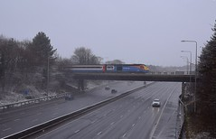 In wintery conditions, East Midlands Trains HST 43048 with 43043 on the rear passing over the M1 Motorway at Trowell with the 09.50 Leeds - St Pancras service, next stop Nottingham. 10 12 2017 (pnb511) Tags: m1 motorway hst class43 train bridge railway loco eastmidlandstrains snow cars