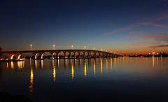Lighting-up time (davebarratt39) Tags: stpete ciega boca usa florida reflection lights sunset