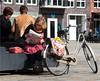 Regarding the News (Hindrik S) Tags: paper krante krant zeitung fyts bicycle bike fiets rad fahrrad streetphoto strjitfotografy straatfotografie strjitte street straat strasse rue saailân zaailand liwwadden ljouwert leeuwarden people minsken menschen mensen dame vrouw frou frau woman read reading lêze lezen lesen relax leisure plein tamron tamronaf16300mmf3563dillvcpzdmacrob016 80mm