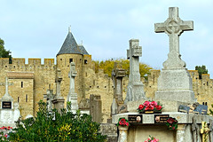 Cemetery at the Medieval City of Carcassonne (Colorado Sands) Tags: france carcassonne europe french sandraleidholdt cemetery cross christian religious christianity graves burialground southernfrance unesco medieval tomb tower fortress watchtower