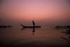 Kolavai at dawn (Karthikeyan.chinna) Tags: karthikeyan chinnathamby chinna canon canon5d silhouette dawn sunrise colors reflection lake water people boat fishing chengalpattu tamilnadu india south nature cwc chennaiweekendclickers