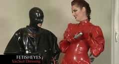 Fetisheyes 'Vacsuit Dressing' Video 03 (videofromfetisheyes) Tags: rubber latex suit vacuum girls women gummi anzug catsuit hood helmet mask enclosure seriouskit kinky games