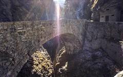 May we build bridges and be successful in 2018! (PeterThoeny) Tags: viamala zillisreischen switzerland bridge old oldbridge stonebridge day lensflare sun sunray ray light nex6 selp1650 3xp raw photomatix hdr qualityhdr qualityhdrphotography zillis gorge ravine canyon rock tree fav200