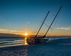 Phantom sunset . . . (Dr. Farnsworth) Tags: sailboat abandoned washedup mirmarbeach sunset gulfofmexico destin fl florida winter january2018 dockbay