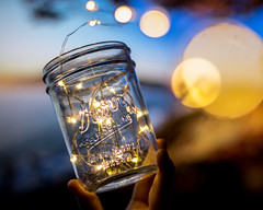 Holding the jar in front of a sunset (Alex Wilson Photography) Tags: lights light lighting yellow fairy led leds wire room decorating jar jars kerr self sealing glass coinjar coin hand hands