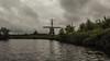 Endzeit-Windmühle (gklheim) Tags: ostfriesland mühle windmühle wasser see deutschland germany dunkel dark wind nature sea water