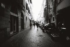 Roma (goodfella2459) Tags: nikon f4 af nikkor 24mm f28d lens ilford hp5 plus 400 35mm blackandwhite film analog roma street bikes cars buildings italy rome bwfp