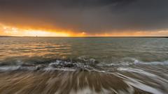 Come rain, come shine (Rob Schop) Tags: bui wideangle sand landscape sunset sonya6000 water nederland outdoor weather pola sea hoyaprofilters sun wolken beach clouds zonsondergang regen motion strand samyang12mmf20 noordzee rain a6000 f16 ouddorp brouwersdam