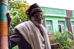 Man in Hawzien (Rod Waddington) Tags: africa african afrique afrika äthiopien ethiopia ethiopian ethnic etiopia ethnicity ethiopie etiopian hawzien hawzen tigray man old shamma walking stick building outdoor portrait people culture cultural orthodox