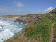 Recording wind chimes, with surf approaching Droskyn Point, Perranporth (Philip_Goddard) Tags: europe unitedkingdom britain british britishisles greatbritain uk england southwestengland cornwall perranporth droskynpoint surf swell sea atlantic recording views scenery landscapes coastpath coast southwestcoastpath nationaltrail southwestway northcoast cliff windchimes