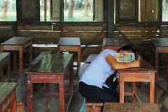 Schoolgirl Sleeping in Detention, Luang Prabang Laos (AdamCohn) Tags: 102kmtobanmoutinlouangphabanglaos adamcohn banmout lao laos louangphabang luangprabang classroom detention geo:lat=19791046 geo:lon=102188653 geotagged rural school schoolhouse student timeout wwwadamcohncom