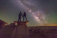 Just south of nowhere... Scaling hoodoo's with my love... Amazing airglow on this night last summer in the Bisti Badlands of New Mexico. (ryan.wykoff) Tags: teamcanon canonusa outerspace milkyway nm fourcorners 14mm rokinon canon newmexico bisti bistibadlands
