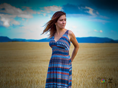 Memoires of summer (Jesús Ibáñez) Tags: girl woman dress summer blue person clothing people sky portrait landscape human photograph outdoor beauty wearing female fairweather brunette photoshoot standing photography grass nature model front face sunlight smiling leisureactivities cleavage busty nice cute lady fashion fun board longhair posing happiness colorful gravel one field road recreation grassfamily outdoors cloud top portraitphotography suit large hat white redhead young hair